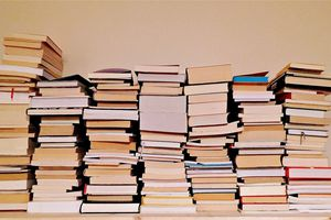 Stacks of books against wall