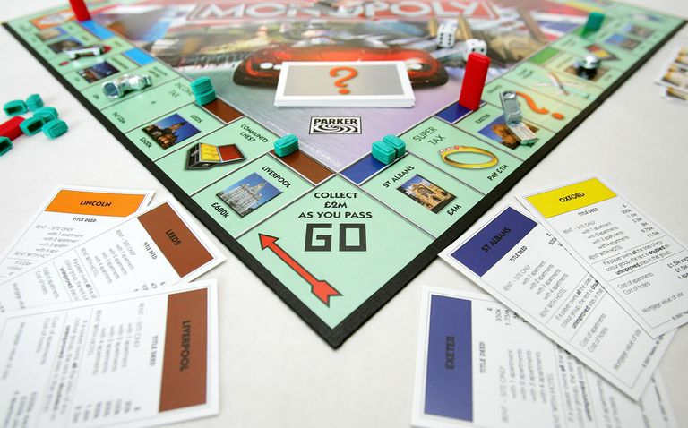 Monopoly game board with money, tokens and dice