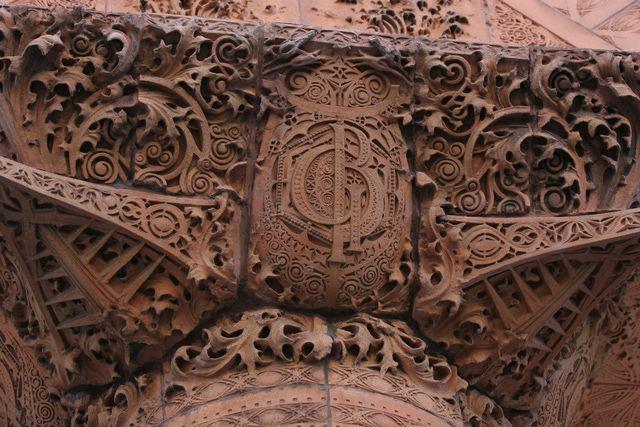 brown sculpted terra cotta detailing, ornate curls and monogram GB