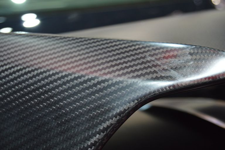 Close up of a carbon fiber car spoiler.
