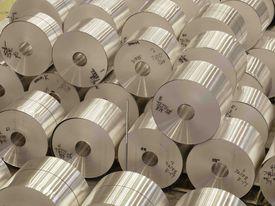 Stacked coils of aluminum sheet at the Novelis plant in Oswego, NY
