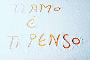 High Angle View Of Italian Text On Snow Covered Metal