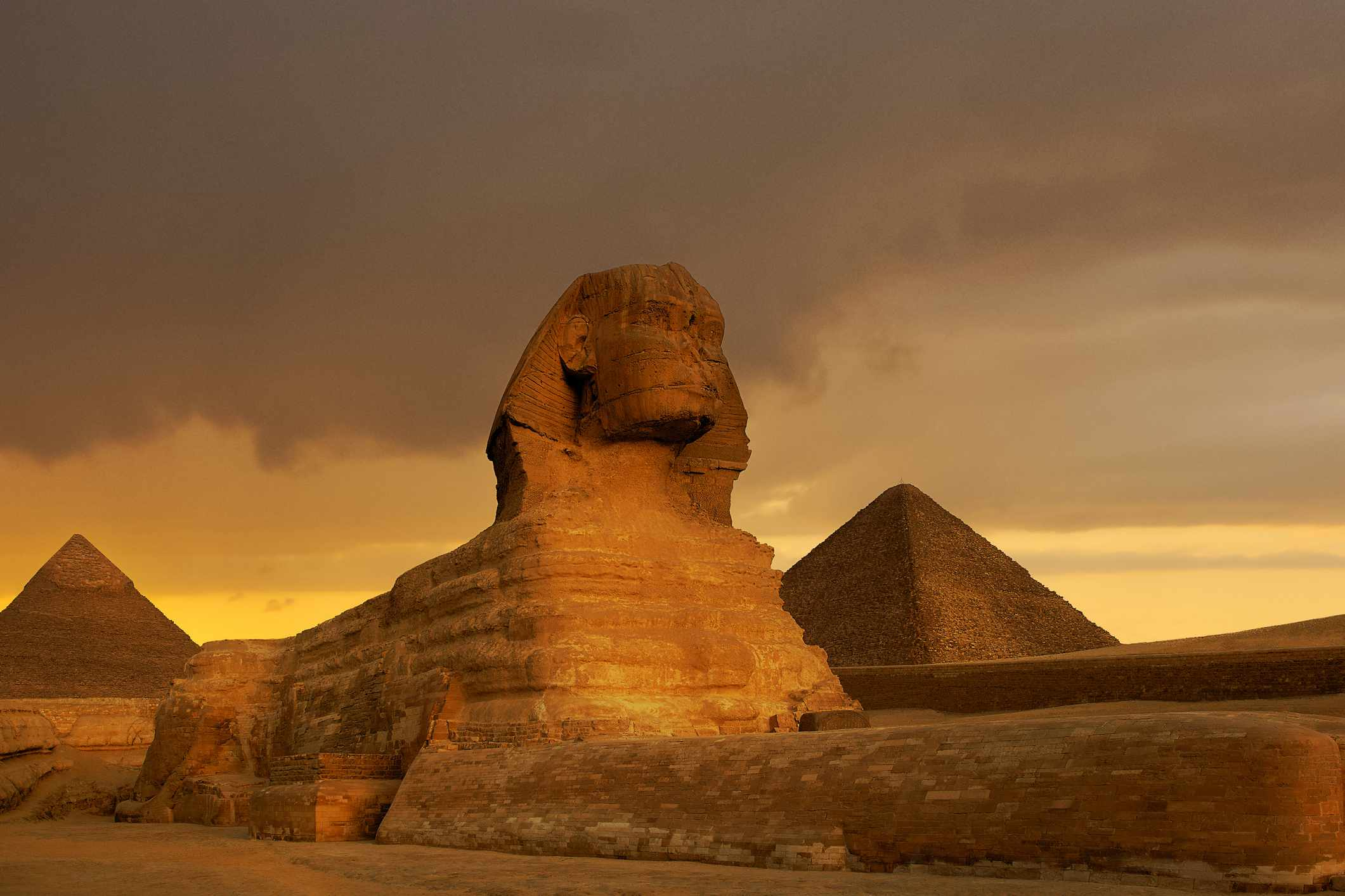 Sunset at the Sphinx and Pyramid complex Giza, Egypt.