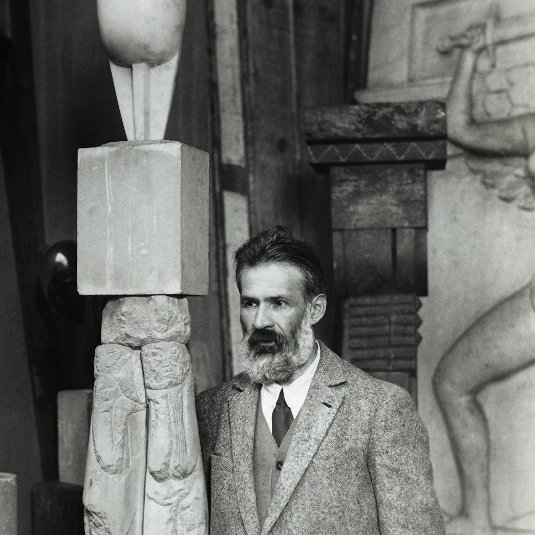 Constantin Brancusi with sculpture