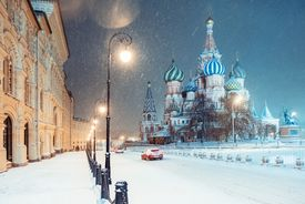 Night view of the Red Square and St. Basil Cathedral in Moscow during snowstorm