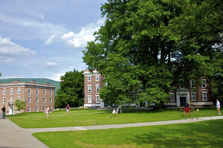 A game of softball on the green lawns of the campus of Williams College