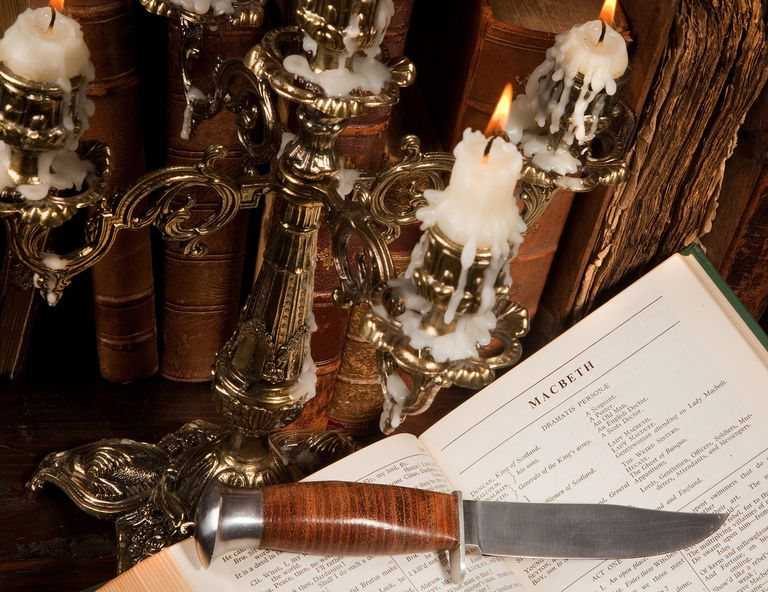 Shakespeare's Macbeth with old books and a candlestick