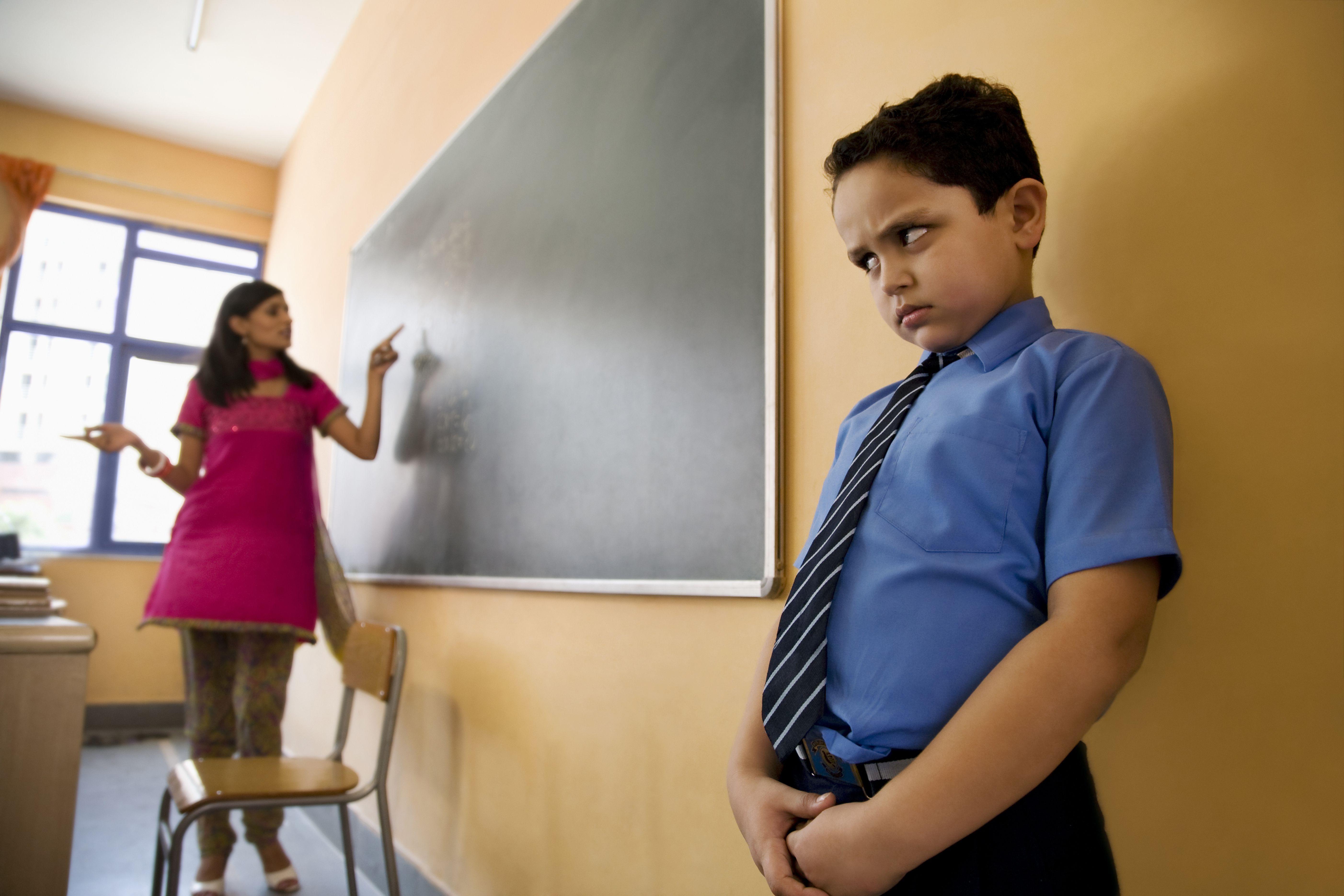 School boy being punished