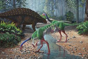Ornithomimus dinosaurs and Panoplosaurus grazing along a stream
