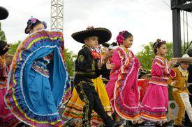 Children in costumes celebrating Cinco de Mayo.