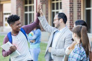 High school teacher gives student a high five