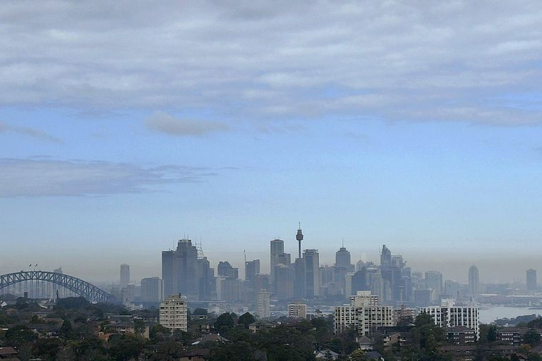 A layer of haze covers the Sydney, Australia skyline