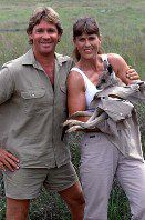 Steve and Terri Irwin pose with a joey, a baby kangaroo