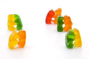 Pairs of Gummy Bears engaged in a formal ballroom dance