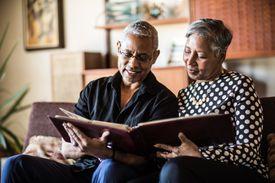 A senior couple looking at a photo album