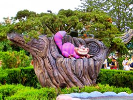 Exhibit showing the Cheshire cat sitting in a tree.