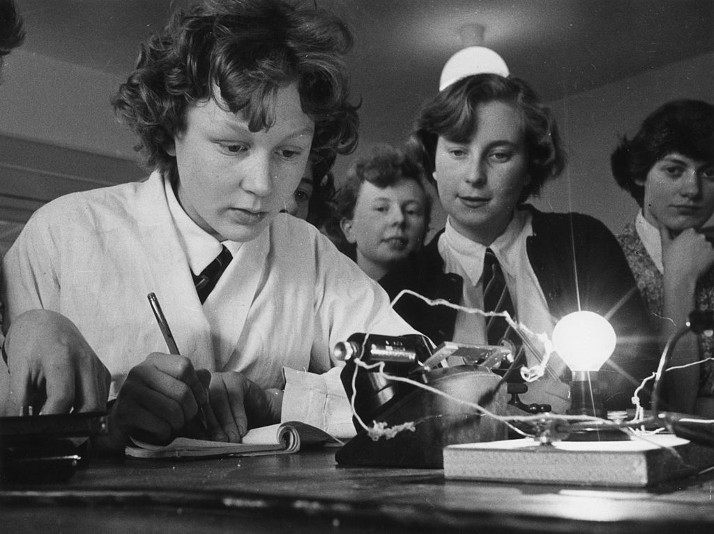 Picture of kids carrying out an electrical physics experiment.