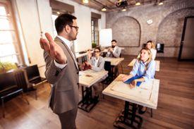 A professor leads discussion in a small seminar