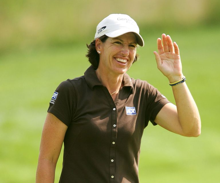 Juli Inkster waves to the crowd after chipping in on the 16th during the Quarterfinals of the HSBC Women's World Match Play Championship on July 8, 2006