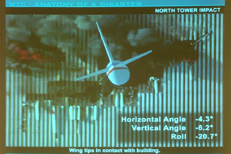 computer presentation slide of wing tips in contact with building, horizontal angle -4.3 degrees, vertical angle -6.2 degrees, and roll -20.7 degrees