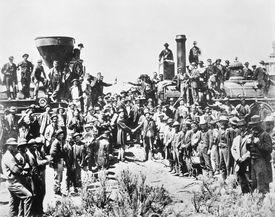 Workers celebrate completion of the Transcontinental Railroad