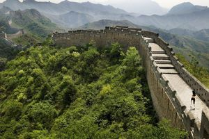 Young woman jogging on Great Wall of China, rear view