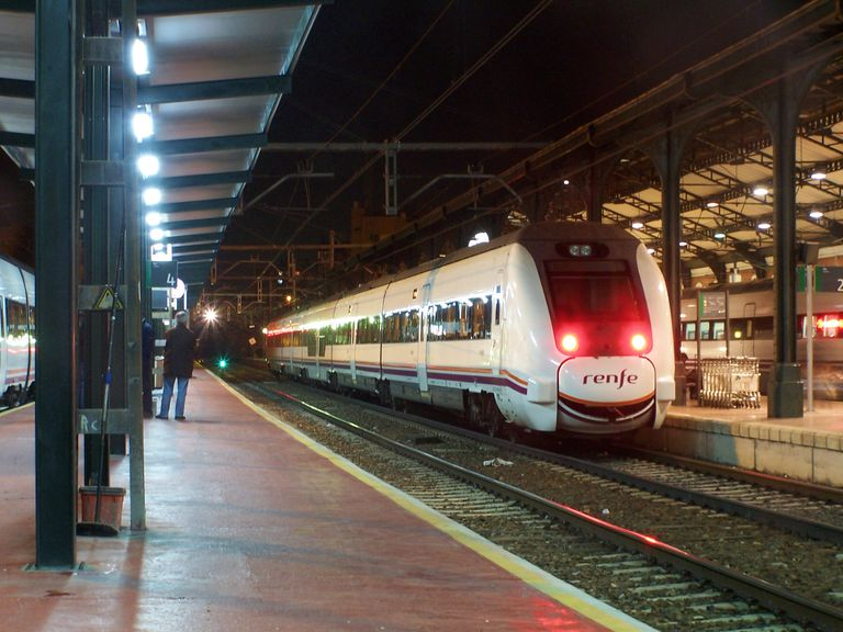 A train in a Spanish train station