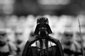 Black and white photo of a Darth Vader figurine.