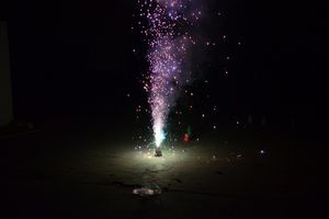 A small firework shoots colored sparks