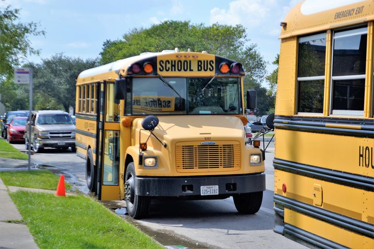 School buses stopped for children.
