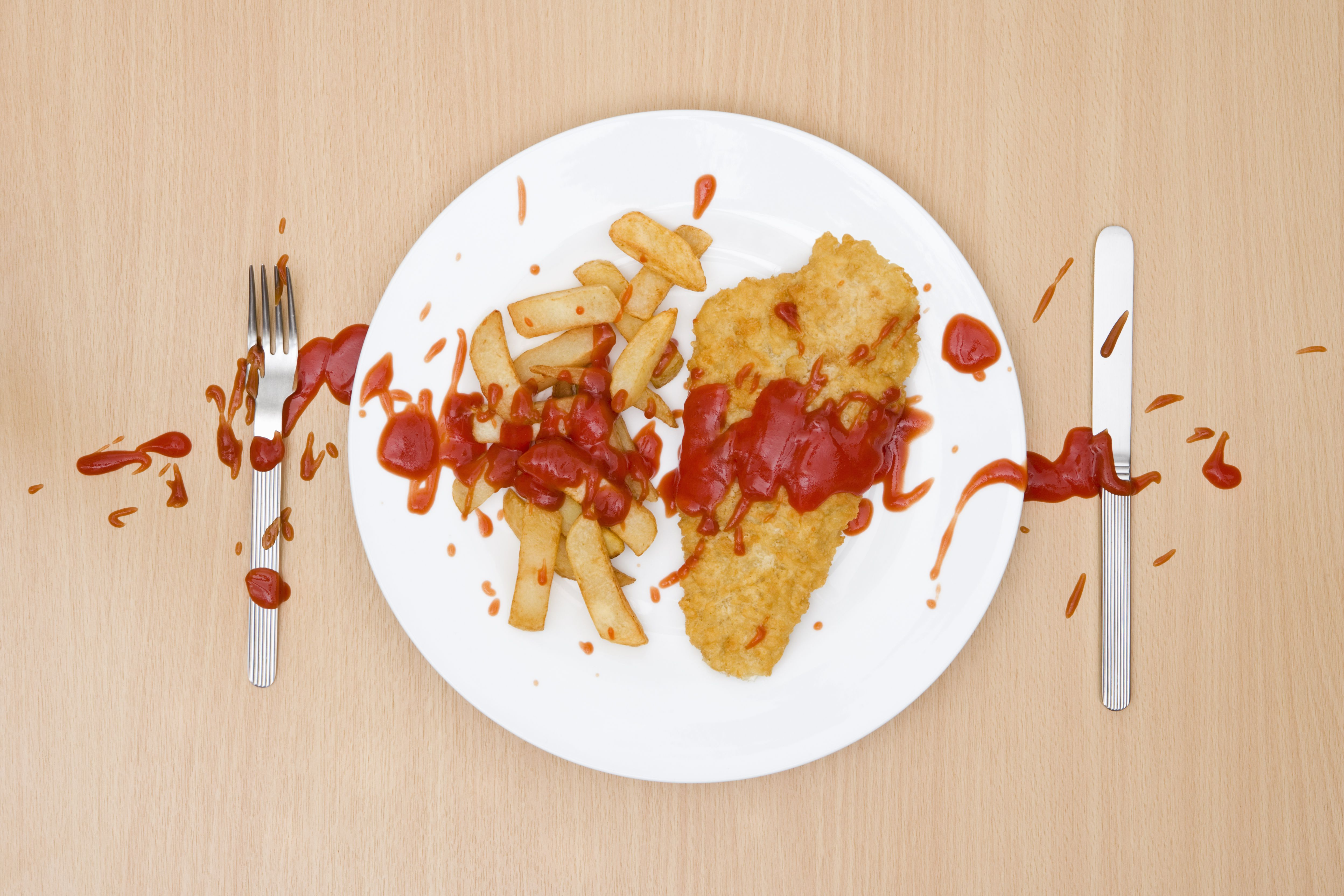 Fish and chips with spilled tomato ketchup