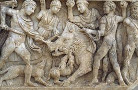 Carved depiction of an ancient boar hunt