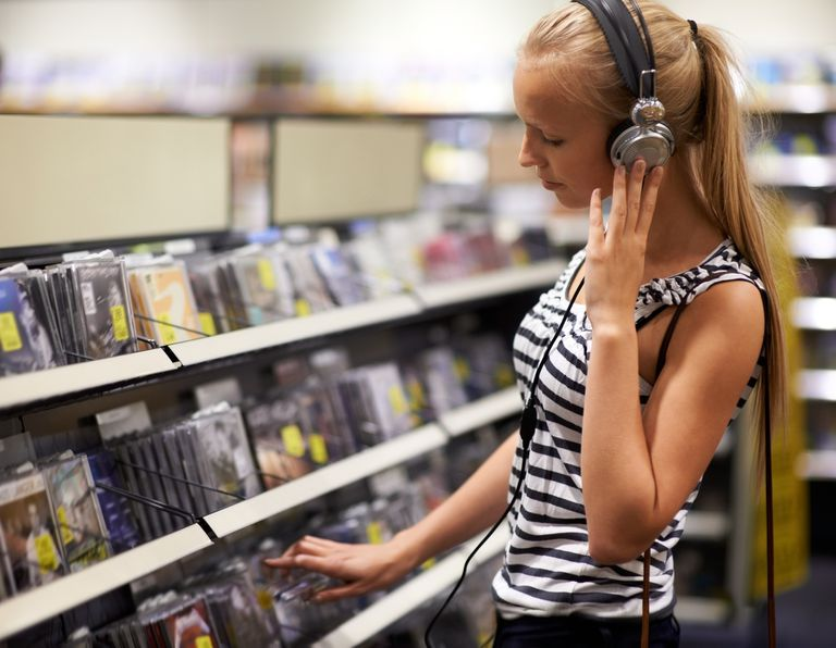 woman listening to music and browsing CDs