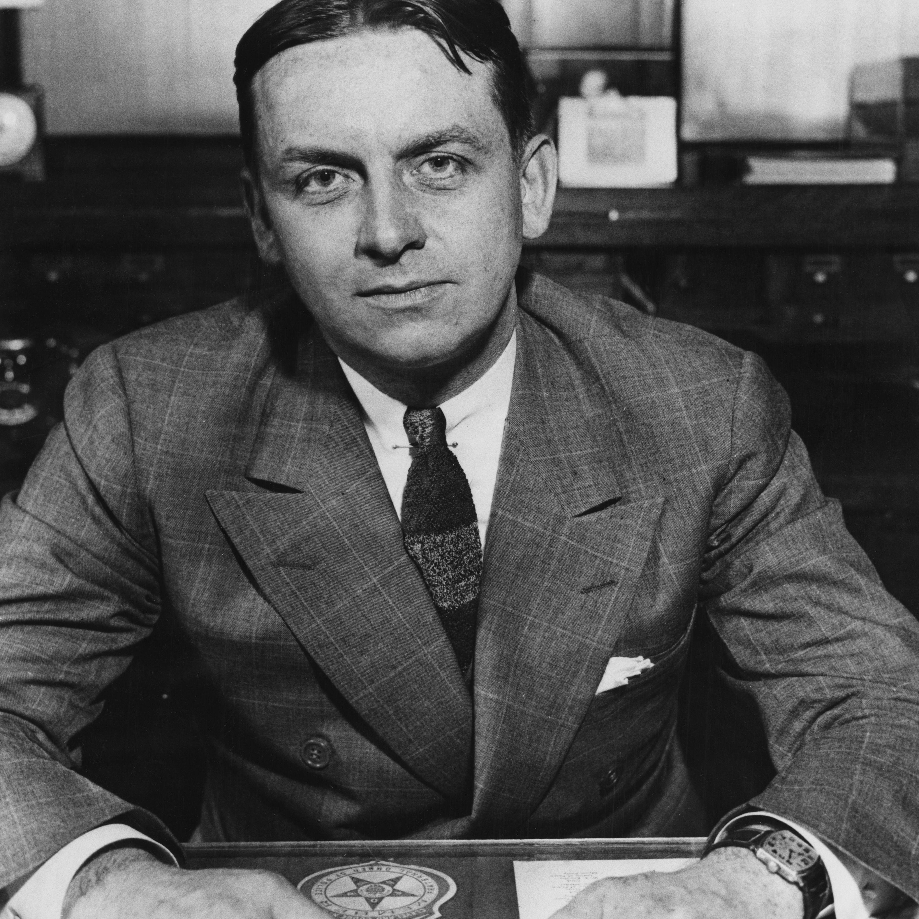 FBI Agent Eliot Ness Seated At Desk, c. 1930.