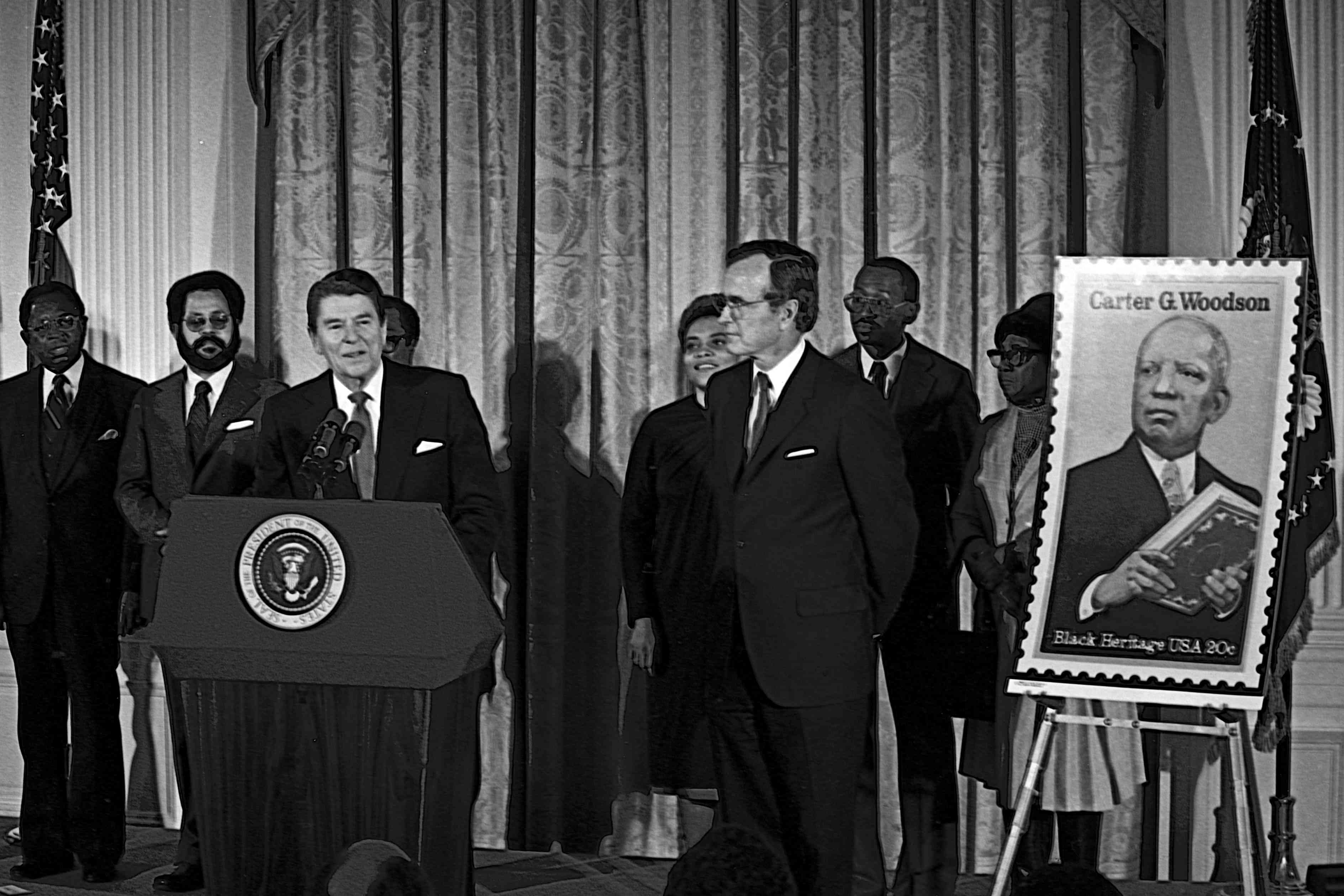 President Reagan speaking to a crowd with new Carter G. Woodson stamp off to the side