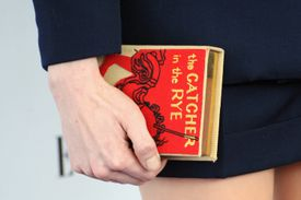 Actress Michelle Williams holding a copy of The Catcher In The Rye