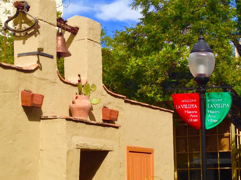 Pueblo architecture, with pottery and flags, La Villita in San Antonio, Texas