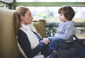 child speaking to mother