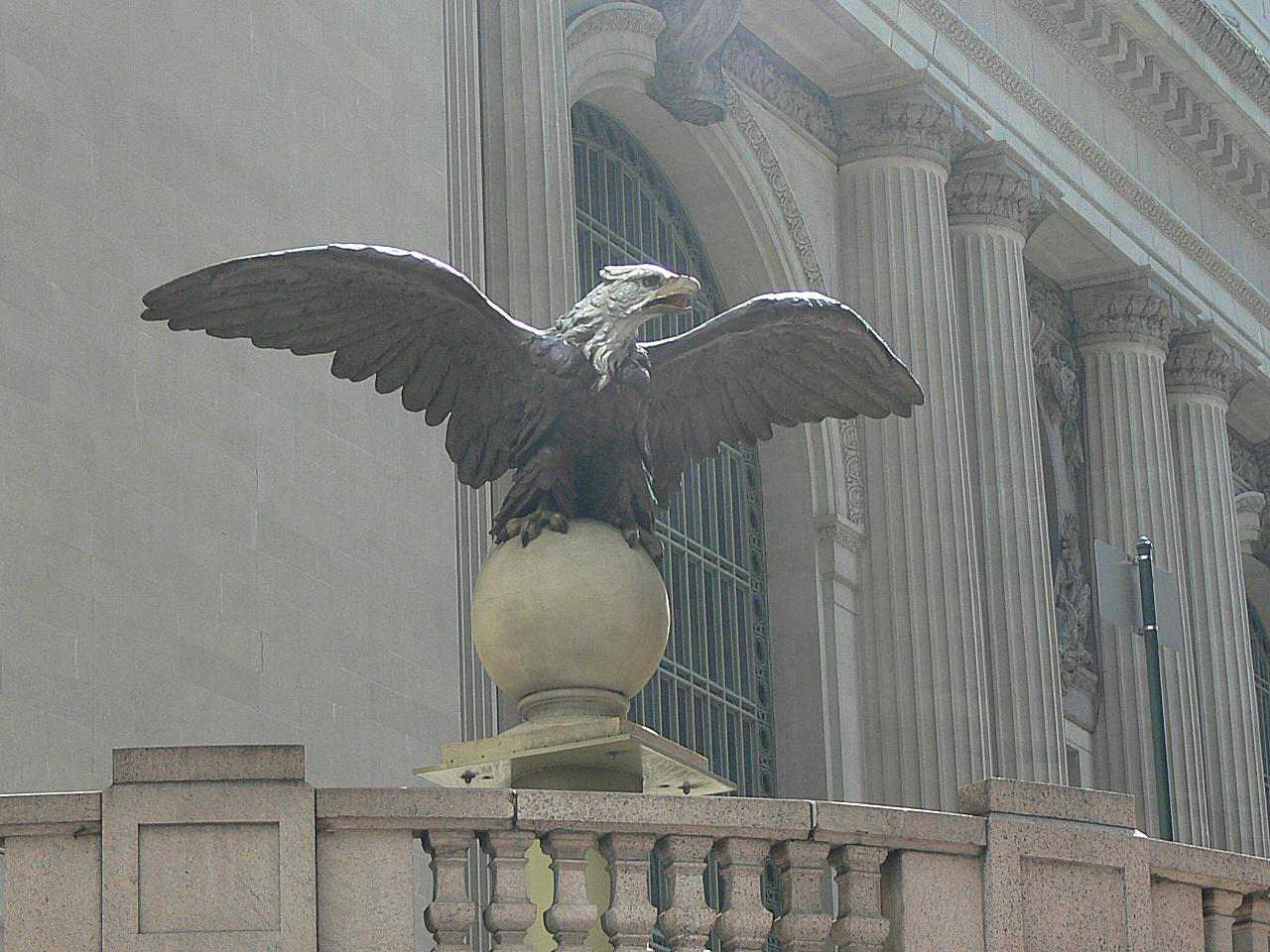 Front view of cast iron eagle high above an entrance to Grand Central Terminal.