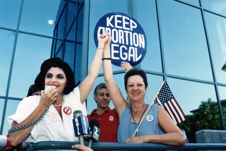 Gloria Allred Norma McCorvey sitting behind microphones at Pro Choice Rally