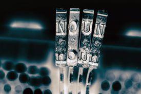 The word NOUN with old typewriter keys