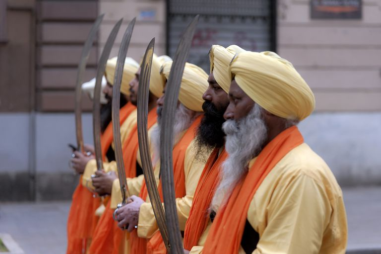 Sikh men marching in a Vaisakhi parade