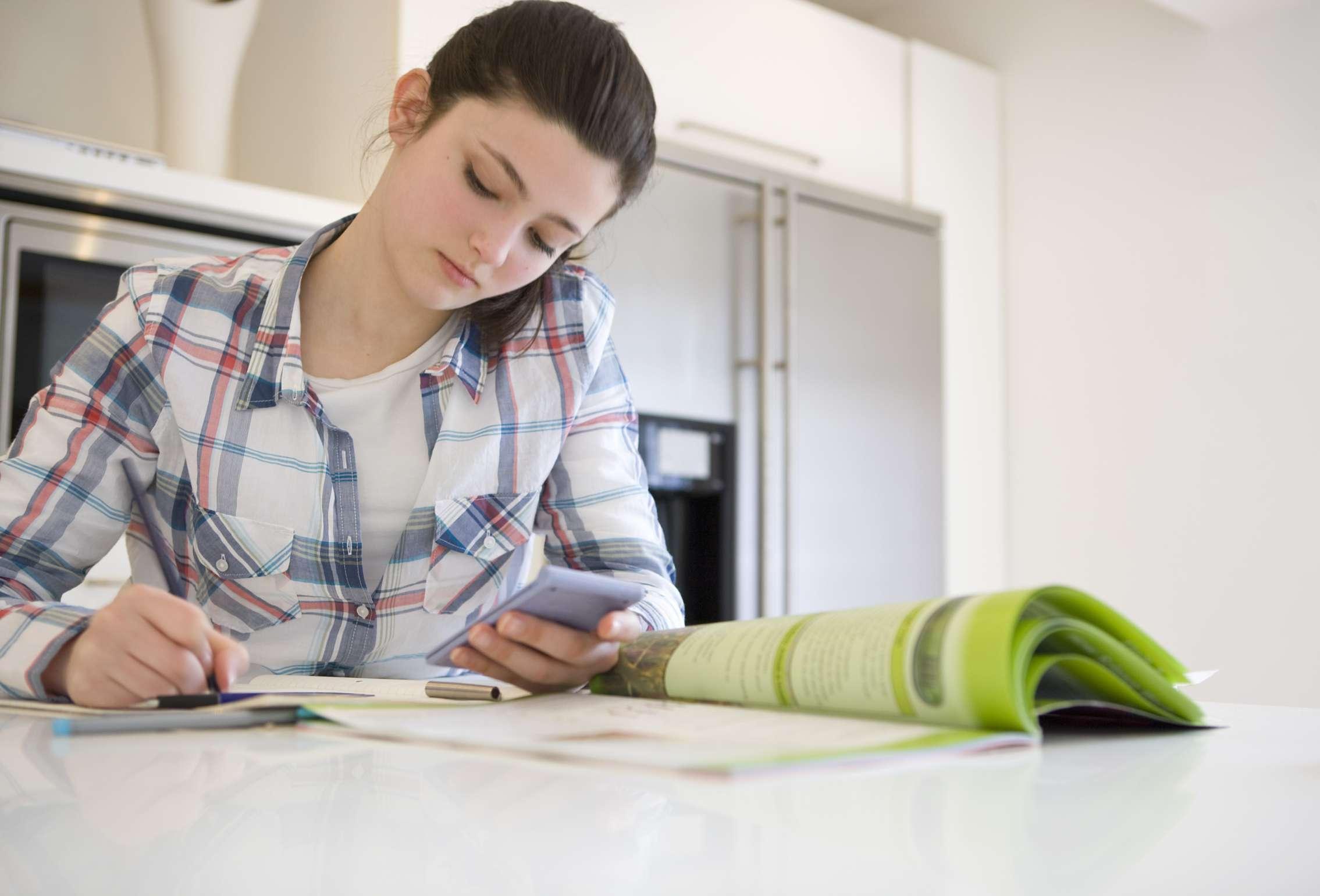 Online high school student studies with calculator.