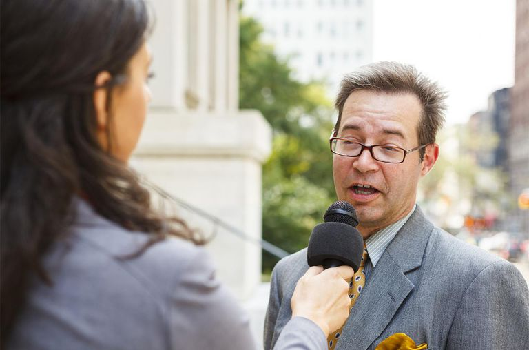 reporter interviewing a man