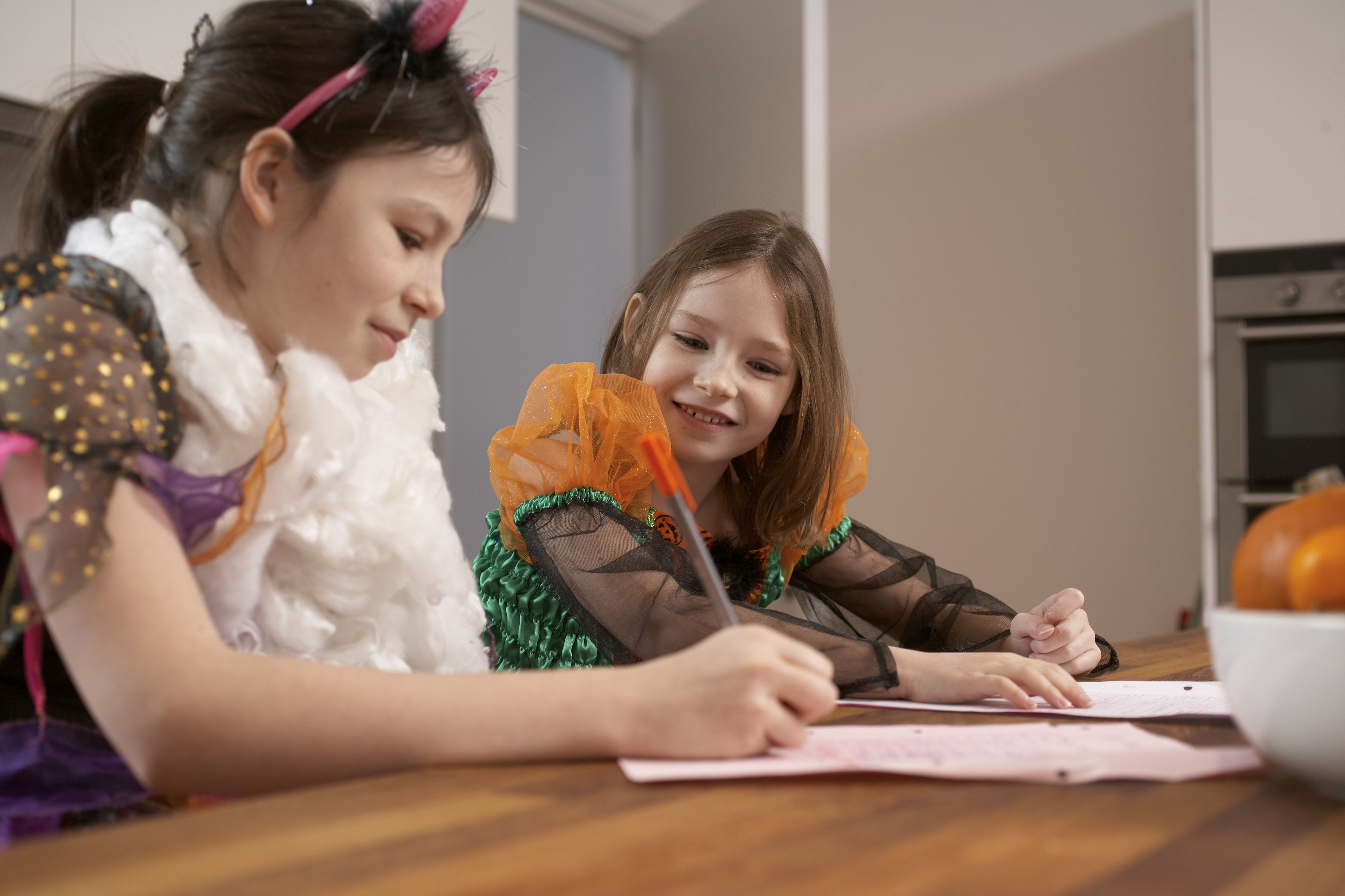 Girls studying in Halloween costumes