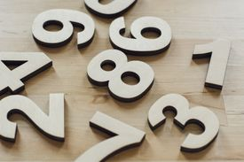Wooden cutout numbers sitting on a table