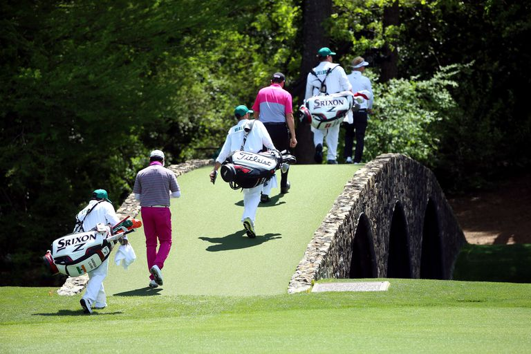 Soren Kjeldsen, Jimmy Walker and Anirban Lahiri cross the Hogan Bridge at Augusta Naitonal