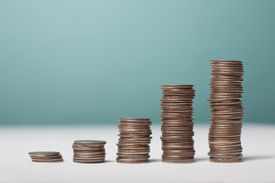 Coins are arranged in stacks that increase in height.