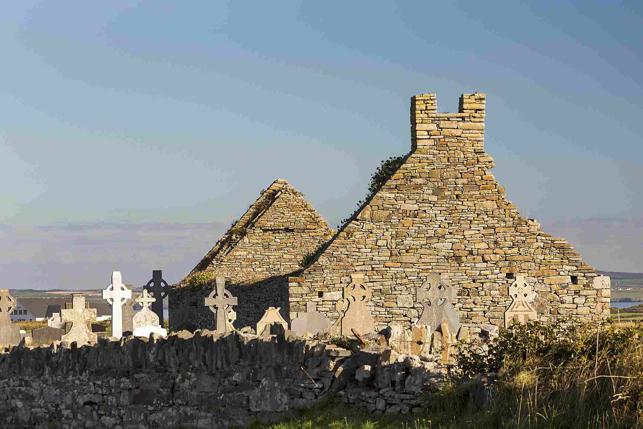 Celtic crosses and old stone church in County Clare, Ireland.