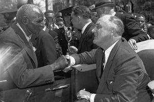 President Roosevelt and George Washington Carver.